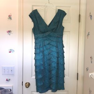 Knee length, ruffled teal dress